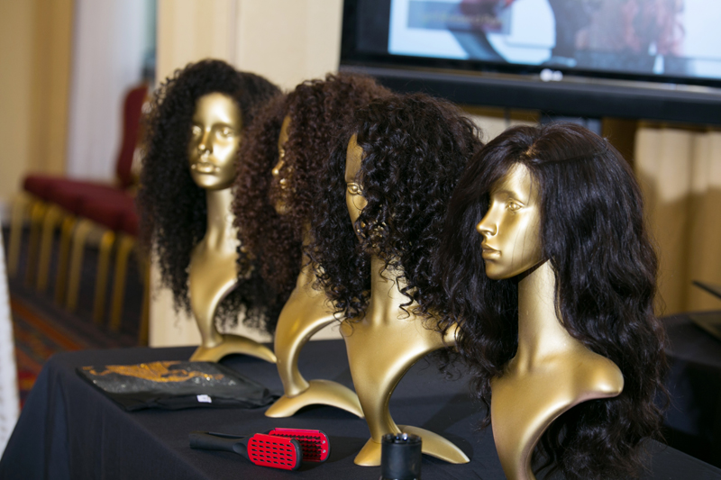 custom wigs on gold display