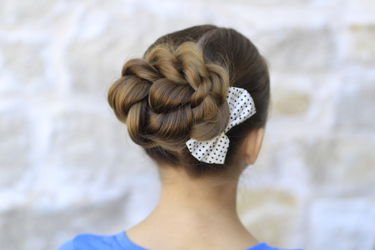 To achieve a fuller twisty bun, wear your hair like pigtails.